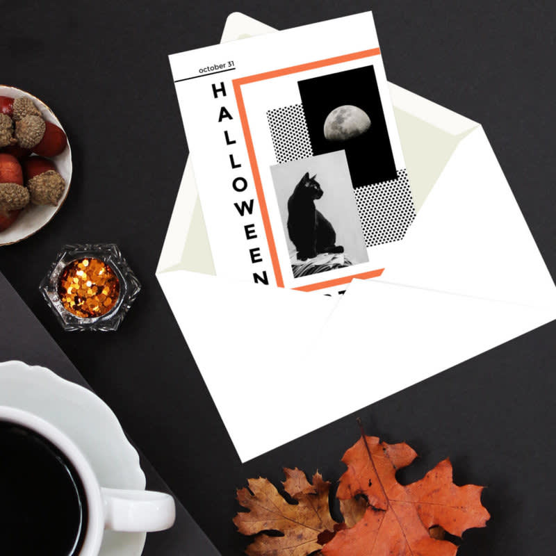 Flat lay photography featuring open Halloween party invitation, fall leaves, coffee, and snacks.