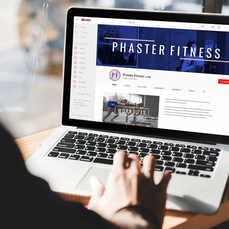 """Laptop with YouTube channel open and """"Phaster Fitness"""" YouTube banner visible."""